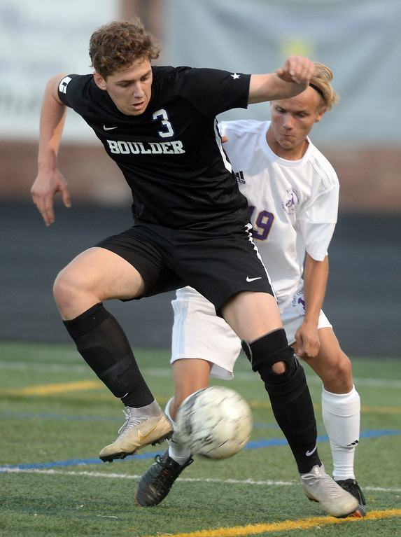 . BOULDER, CO - SEPTEMBER 13: Jesse Bacardi, of Boulder, keeps the ball away from Jack Chunko, of Ft Collins. Boulder High played Ft Collins High at Recht Field on Thursday. (Photo by Cliff Grassmick/Staff Photographer)