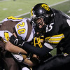 Record-Eagle/Keith King<br /> Bay City Western's Mason Myers (20) is brought down by Traverse City Central's Drew Reamer (85) and Weston deTar (10), bottom, Friday, October 26, 2012 at Thirlby Field in Traverse City.
