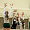Record-Eagle/Jan-Michael Stump<br /> Traverse City Central's Jessie Kushner (11) spikes the ball between Traverse City West's Katie Placek (11) and Allison Peters (5) in the first game of Wednesday's match.