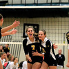 Record-Eagle/Jan-Michael Stump<br /> Traverse City Central's Kiley Kowal (7) and Abby Underwood (12) celerbrate a point in the second game of Wednesday's match at Traverse City West.