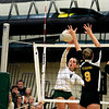 Record-Eagle/Jan-Michael Stump<br /> Traverse City Central's Brie Goodno (9) and Abby Underwood (12) try to block Traverse City West's Kimmy Bilinski (4) in the second game of Wednesday's match.