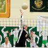 Record-Eagle/Jan-Michael Stump<br /> Traverse City Central's Lauren Lozowski (6) spikes the ball in the first game of Wednesday's loss to Traverse City West