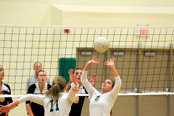 Record-Eagle/Jan-Michael Stump<br /> Traverse City West's Allison Peters (5) sets for Katie Placek in the first game of Wednesday's match.