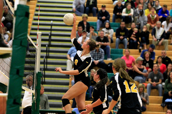 Record-Eagle/Jan-Michael Stump<br /> Traverse City Central's Brie Goodno (9) spikes the ball in the third game of Wednesday's loss at Traverse City West.