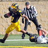 Pat Christman<br /> Gustavus Adolphus College running back Jeff Dubose runs for one of his three first half touchdowns against Carleton Saturday at Hollingsworth Field.
