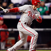 Philadelphia Phillies' Chase Utley watches his solo home run clear the fence in first inning of Game 3 in a National League baseball division series against the Colorado Rockies in Denver on Sunday, Oct. 11, 2009. (AP Photo/Jack Dempsey)