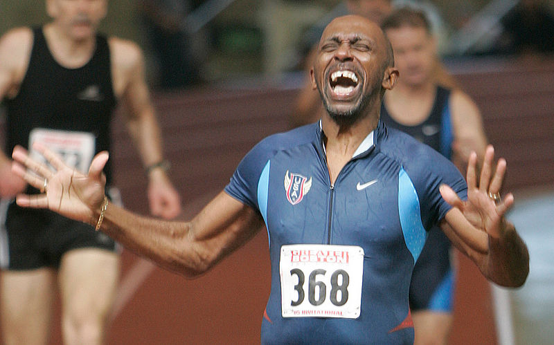 Carroll Blake, 55, rejoices as he crosses the finish line to win the masters 400m run in 55.98.