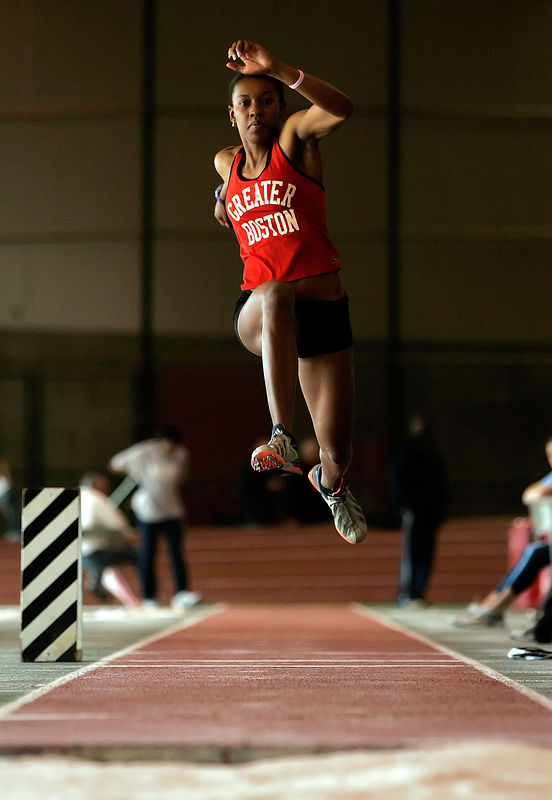 "GBTC member Sherita Williams soars into the air in the triple jump, setting a new club, meet, and facility record with a 44' 3/4"" jump."