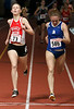 """In a race Coach Tom Derderian called """"the battle of good versus evil"""", GBTC runner Sloan Siegrist tries to outkick BAA runner Mariko Holbrook at the finish line in the open women's 3000m.  Holbrook held onto the win in 10:03.33, edging out Siegrist by one hundredth of a second (10:03.34)."""