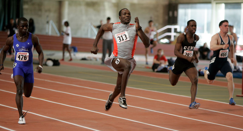Clement Campbell (313) of the Executive Track Club gets some serious air as he wins the 60m dash in 6.78s.