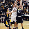 CARL RUSSO/Staff photo. Central's captain, Casey McLaughlin (33) battles for the ball with Andover's captain, Jackie Alois (33) and Abby Katz (left) in basketball action. Central Catholic defeated Andover 54-35 in the first semi-final basketball game of the Greater Lawrence Christmas Tournament Friday night. 12/28/2012.