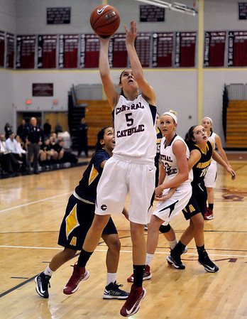 CARL RUSSO/Staff photo. Central's Amanda Williams drives to the hoop for the basket in basketball action. Central Catholic defeated Andover 54-35 in the first semi-final basketball game of the Greater Lawrence Christmas Tournament Friday night. 12/28/2012.