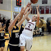 CARL RUSSO/Staff photo. Central's Courtney Walsh (2) drives to the hoop against Andover's Abby Katz (15) and Devon Caveney in basketball action.  Central Catholic defeated Andover 54-35 in the first semi-final basketball game of the Greater Lawrence Christmas Tournament Friday night. 12/28/2012.