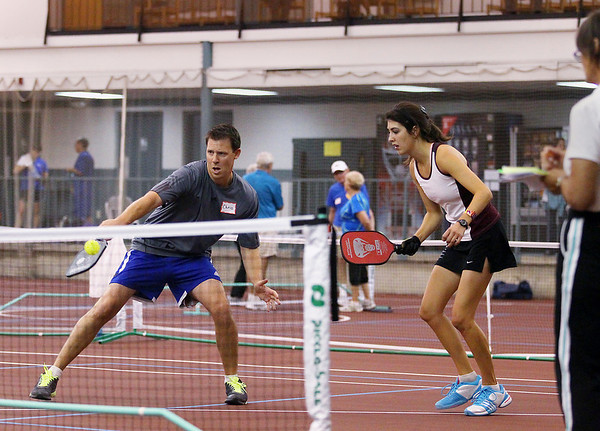 Record-Eagle/Keith King<br /> Chris Conflitti, of Grand Rapids, hits the ball near mixed doubles partner, Jessica LeMire, of Grand Rapids, Friday, September 21, 2012 during the Great Lakes Open Pickleball Tournament at the Grand Traverse Bay YMCA in Traverse City.