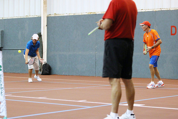 Record-Eagle/Keith King<br /> Yvonne Hackenberg, of Kalamazoo, hits the ball near husband and mixed doubles partner, Jim Hackenberg, Friday, September 21, 2012 during the Great Lakes Open Pickleball Tournament at the Grand Traverse Bay YMCA in Traverse City.