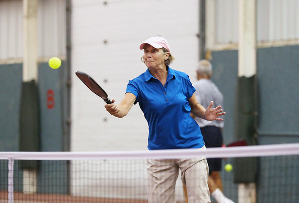Record-Eagle/Keith King<br /> Yvonne Hackenberg, of Kalamazoo, hits the ball during mixed doubles play Friday, September 21, 2012 during the Great Lakes Open Pickleball Tournament at the Grand Traverse Bay YMCA in Traverse City.