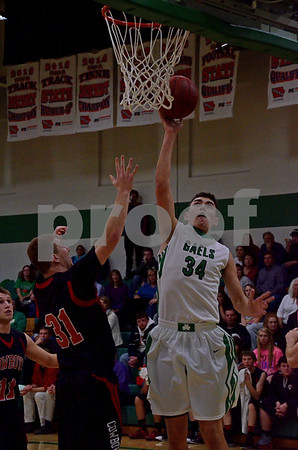-Messenger photo by Britt Kudla<br /> Konrad Laufersweiler of St. Edmond scores from inside the paint against Clarion-Goldfield  on Tuesday