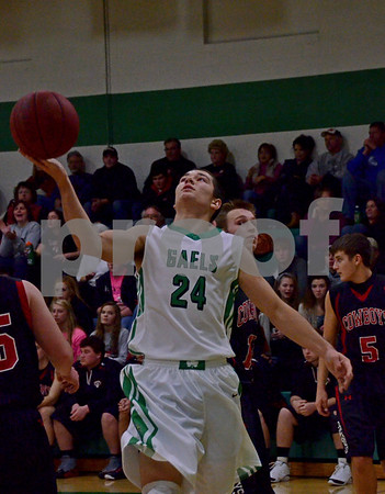 -Messenger photo by Britt Kudla<br /> Landon Peed of St. Edmond makes a shot against Claion-Goldfield on Tuesday