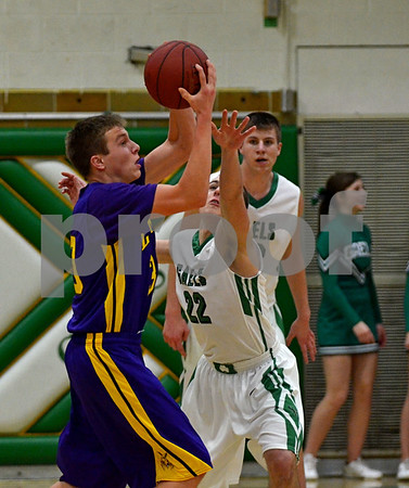 -Messenger photo by Britt Kudla<br /> Tate O'Tool of St. Edmond attempts to take away the ball from Webster City's Logan Yates on Tuesday night inside Gaels gym