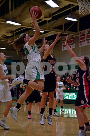 -Messenger photo by Britt Kudla<br /> Anna Yung of St. Edmond scores from inside the paint against Clarion-Goldfield on Tuesday