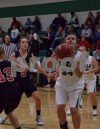-Messenger photo by Britt Kudla<br /> Clare Flattery of St. Edmond goes up for the shot during Tuesday night game against Clarion-Goldfield