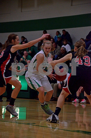 -Messenger photo by Britt Kudla<br /> Jaci Stumpf of St. Edmond drives to the basket against Clarion-Goldfield on Tuesday night