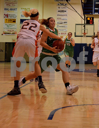 -Messenger photo by Britt Kudla<br /> Anna Yung of St. Edmond drives towards the hoop against Manson NW Webster on Thursday