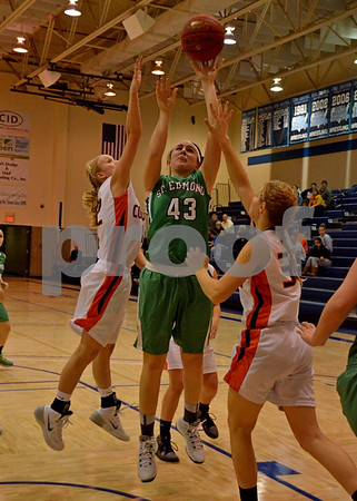 -Messenger photo by Britt Kudla<br /> Alli Huss of St. Edmond shoots from inside the paint during Thursday night game against Manson NW Webster
