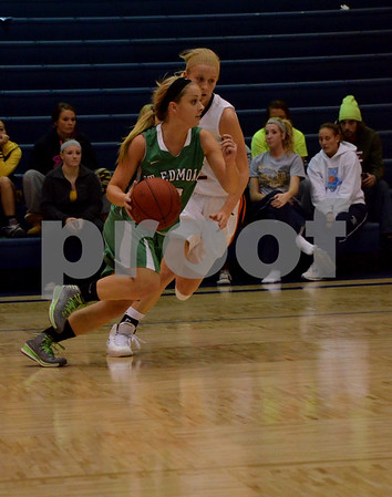 -Messenge photo by Britt Kudla<br /> Maddie McCarville of St. Edmond dribbles down the court during Thursday game at Iowa Central's High School Jamboree