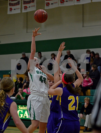 -Messenger photo by Britt Kudla<br /> Alli Huss of St. Edmond shoots over Webster City's (21) Hanna Myers on Tuesday inside Gaels gym