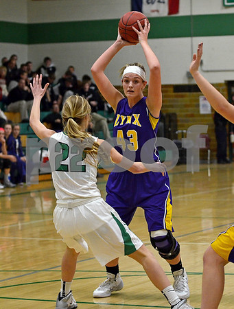 -Messenger photo by Britt Kudla<br /> Mikala Harrill of Webster City looks an opening towards the basket on Tuesday night against St. Edmond