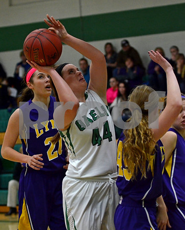-Messenger photo by Britt Kudla<br /> Madeline Baldwin of St. Edmond shoots inside the paint against Webster City on Tuesday