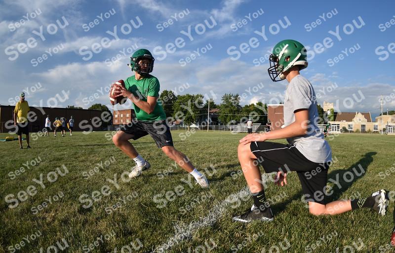 -Messenger photo by Britt Kudla<br /> Drew Schaeffer of St. Edmond drop back for a pass during Gaels practice on Tuesday