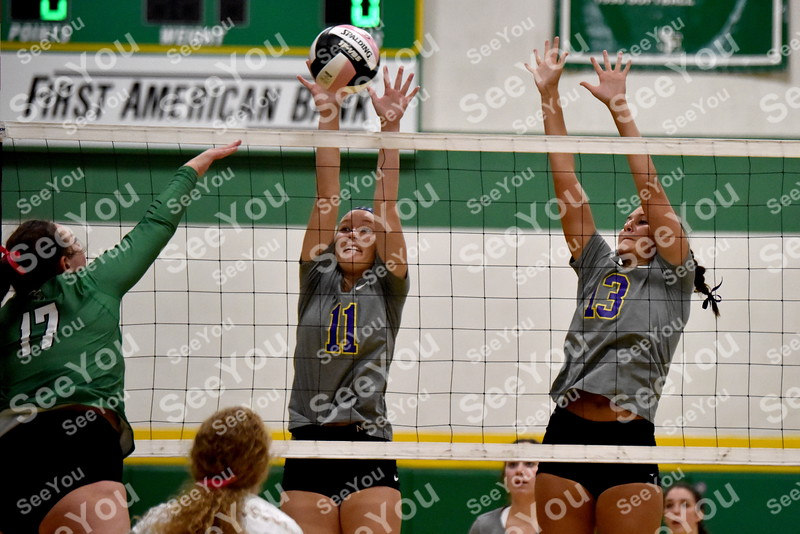 -Messenger photo by Britt Kudla<br /> Webster City Sydney Carver (11) and Kamry Dawson makes a block against St. Edmond during Gaels Invite on Saturday