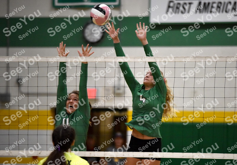 -Messenger photo by Britt Kudla<br /> St. Edmond Chloe Lewison (11) and Devyn Scott goes up for a block against Webster City during Gaels Invitational on Saturday
