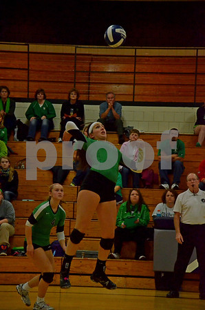 -Messenger photo by Britt Kudla<br /> Alli Huss of St. Edmond spikes the ball against Manson Northwest Webster during Tuesday Regional Volleyball game