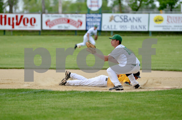 -Messenger photo by Britt Kudla<br /> Michael Sharkey of St. Edmond attempts to tag out a West Marshall's runner during the third inning on Monday