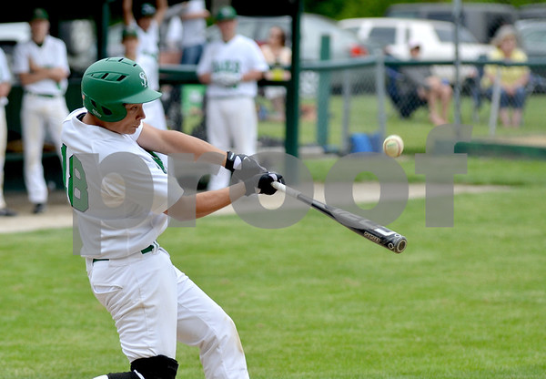 -Messenger photo by Britt Kudla<br /> Michael Sharkey of St. Edmond connects for a single during the fourth inning against West Marshall on Monday