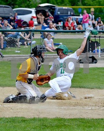 -Messenger photo by Britt Kudla<br /> Hank Crimmins of St. Edmond slides into home giving the gaels a comfortable lead in the fourth inning against West Marshall on Monday