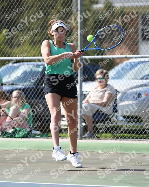 -Messenger photo by Britt Kudla<br /> Jaque Oberg of St. Edmond compete against Webster City Hannah Parr on Monday at Butler's Courts