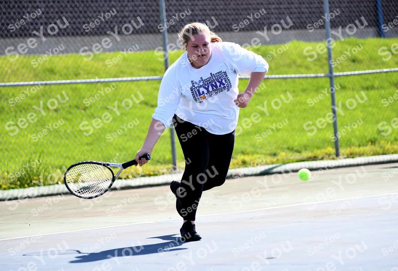 -Messenger photo by Britt Kudla<br /> Hannah Parr of Webster City compete against St. Edmond Jaque Oberg on Monday at Butler Courts
