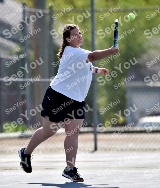-Messenger photo by Britt Kudla<br /> McKenna Dinsdale of Webster City compete against St. Edmond Jillian Cosgrove on Monday at Butler Courts