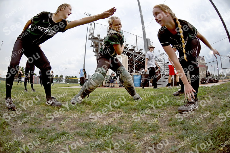 -Messenger photo by Britt Kudla<br /> North Union play freeze tag as they wait out a rain delay on Thursday at Rogers Park