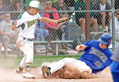 Matthew Smallwood (right), of St. Michael's High School, slides safely past Hope Christian's Neppy Saavedra and into home base during the fourth inning of a baseball game in Albuquerque, N.M. on April 28, 2012. Photos by Natalie Guillén/The New Mexican
