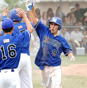 Joey Roybal, of St. Michael's High School, celebrates with his teammates after scoring in the fourth inning during a baseball game against Hope Christian in Albuquerque, N.M. on April 28, 2012. Photos by Natalie Guillén/The New Mexican