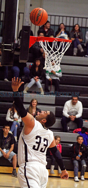 Capital High Jaguar Mikey Lopez, #33 makes a basket during the third quarter of their game against  Bel Air at the Edward A. Ortiz Memorial Gymnasium  on Saturday, December 8, 2012.  Bel Air was up 61-55 in the last minute of the game.  Jane Phillips/The New Mexican