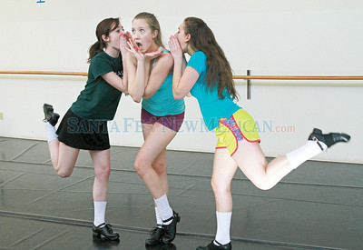 From left, Deena Rice,17, Skye McDiarmid,17 and Shannon Kossmann,15, rehearse a scene for their dance performance at the Lensic, on Friday, March 15th, at Belisama Dance Studio on Saturday, February 23, 2013. Jane Phillips/The New Mexican