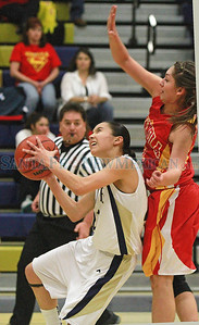 Santa Fe High Savina Padilla , #21, goes up for two points while Española Lauren Quintana, #22 tries to defend during the second quarter of their game at the Toby Roybal Gymnasium on Tuesday, January 22, 2013.  Jane Phillips/The New Mexican