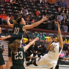 Hope Christian's Brynn Wade, 10 and Christine Helsey, #23 try to keep the ball away from  Santa Fe Indian School's Kayla Joe, #12  at the Pueblo Pavilion Wellness Center on Friday, January 23, 2015.  Jane Phillips/The New Mexican