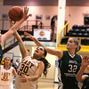Santa Fe Indian School's captain Victoria Lovato, #30, retrieves the ball while Hope Christian's Brielle Milford, #32, tries to defend during the first quarter at the Pueblo Pavilion Wellness Center on Friday, January 23, 2015.  Jane Phillips/The New Mexican
